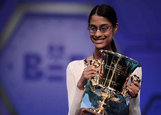 Sukanya Roy, 14, of South Abington Township, Pa., holds the trophy after winning the National Spelling Bee, in Oxon Hill, Md. on Thursday, June 2, 2011. She won by spelling the word cymotrichous, which means wavy hair. (AP Photo/Pablo Martinez Monsivais)